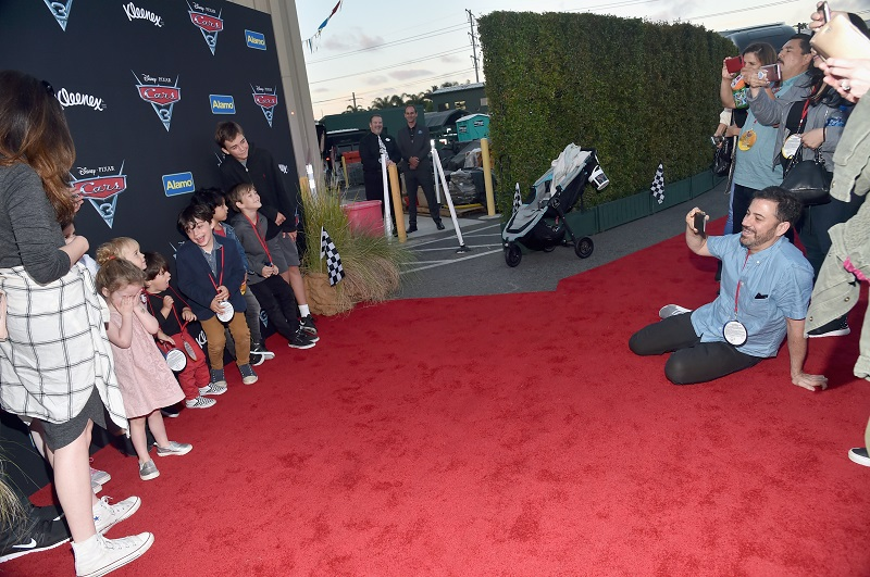 "ANAHEIM, CA - JUNE 10: TV personality Jimmy Kimmel (R, seated) takes a picture of guests at the after party for the World Premiere of Disney/Pixar's ""Cars 3"" at Cars Land at Disney California Adventure in Anaheim, CA. (Photo by Alberto E. Rodriguez/Getty Images for Disney) *** Local Caption *** Jimmy Kimmel"